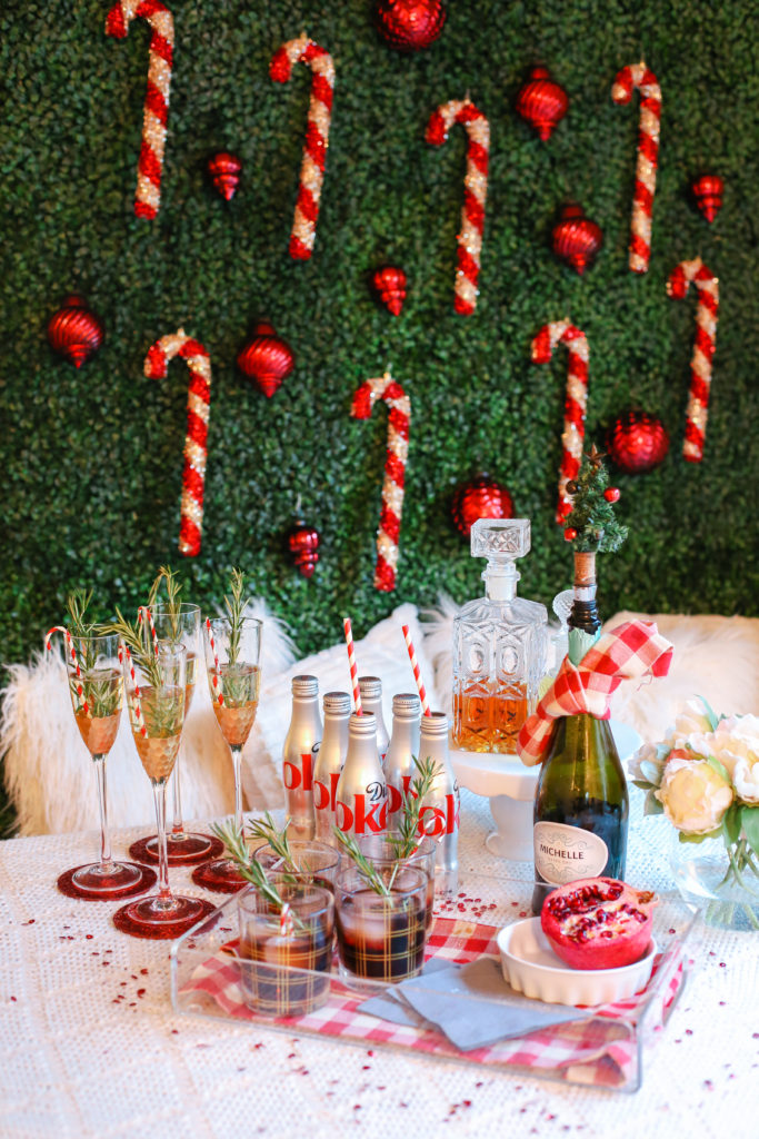 stylish christmas party drink display from thesouthernstyleguide.com, christmas party, christmas drinks, christmas cocktails, holiday bar cart, bar cart, diet coke, champagne cocktail, christmas decorations, holiday style