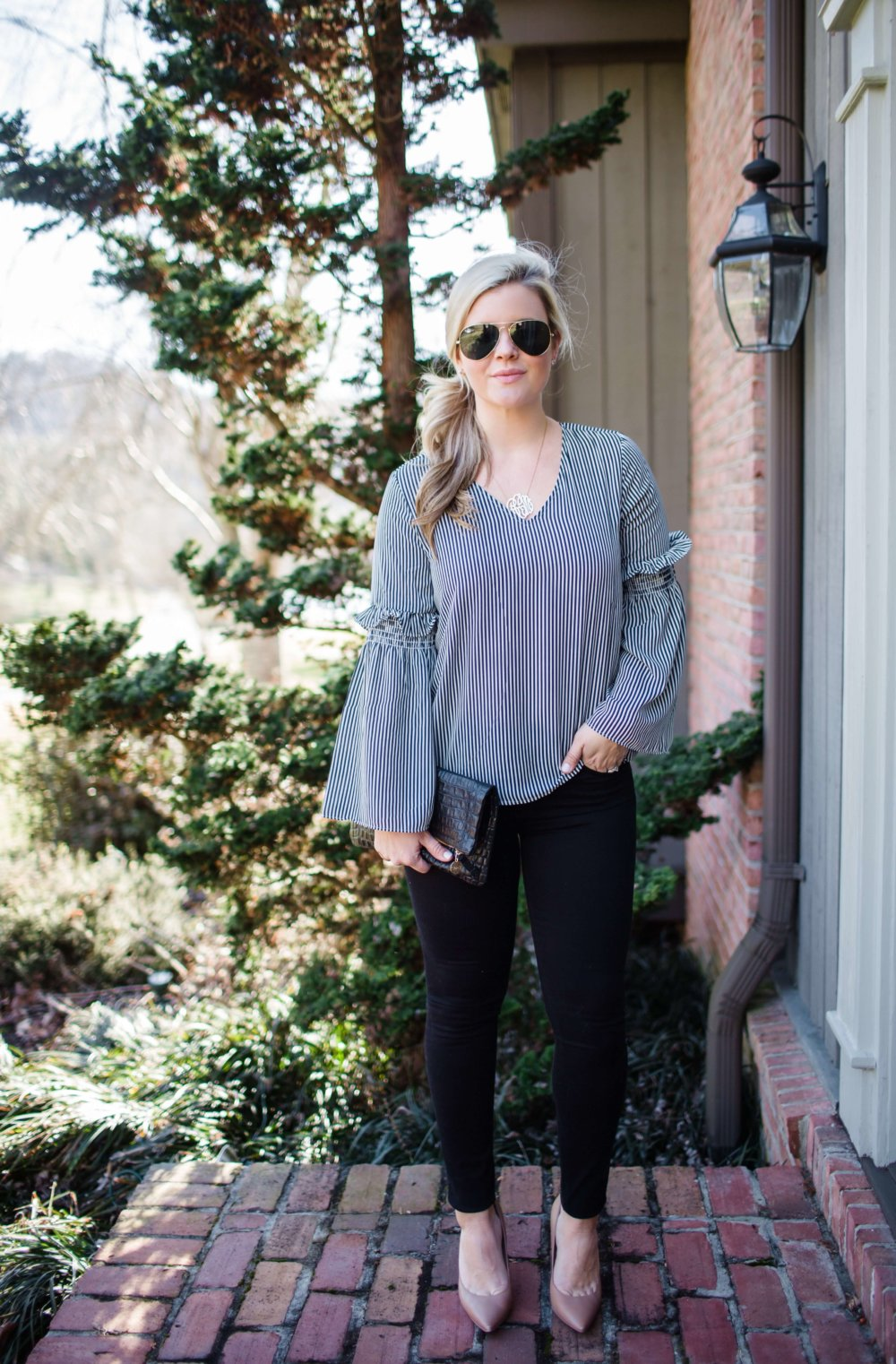striped blouse date night outfit