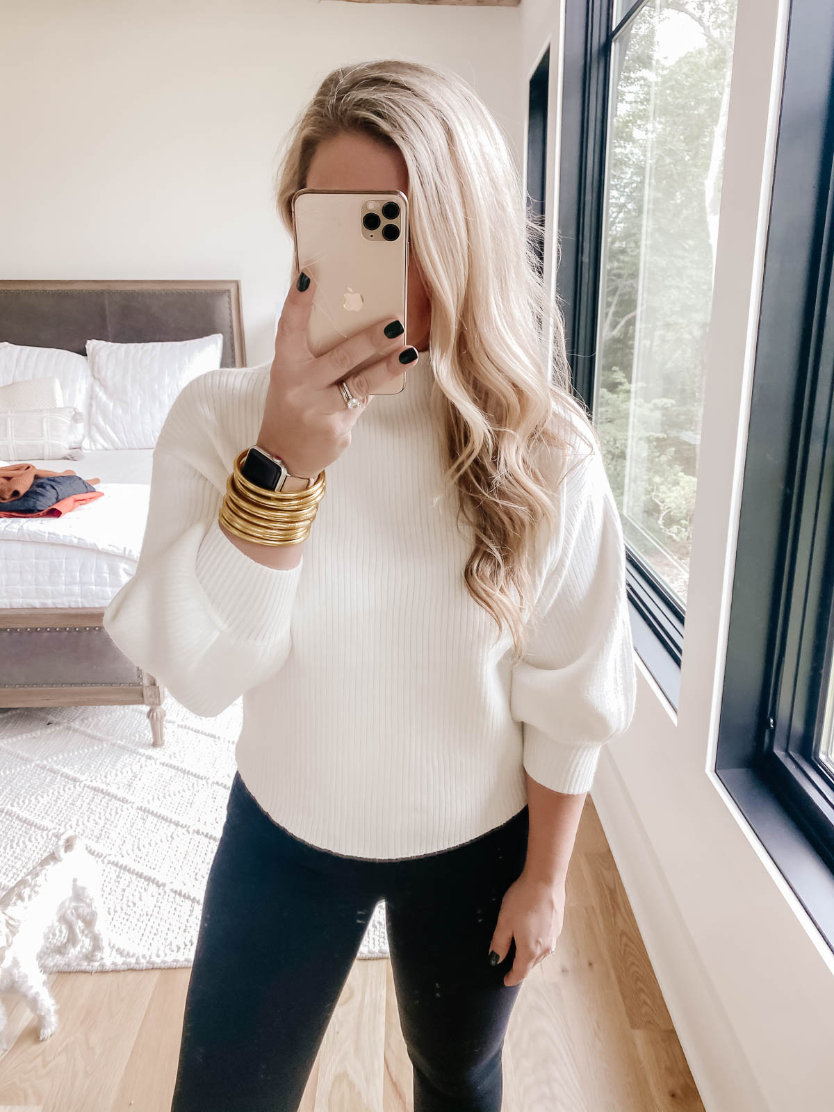 White mock neck sweater and black skinny jeans from Style Blogger Cristin Cooper